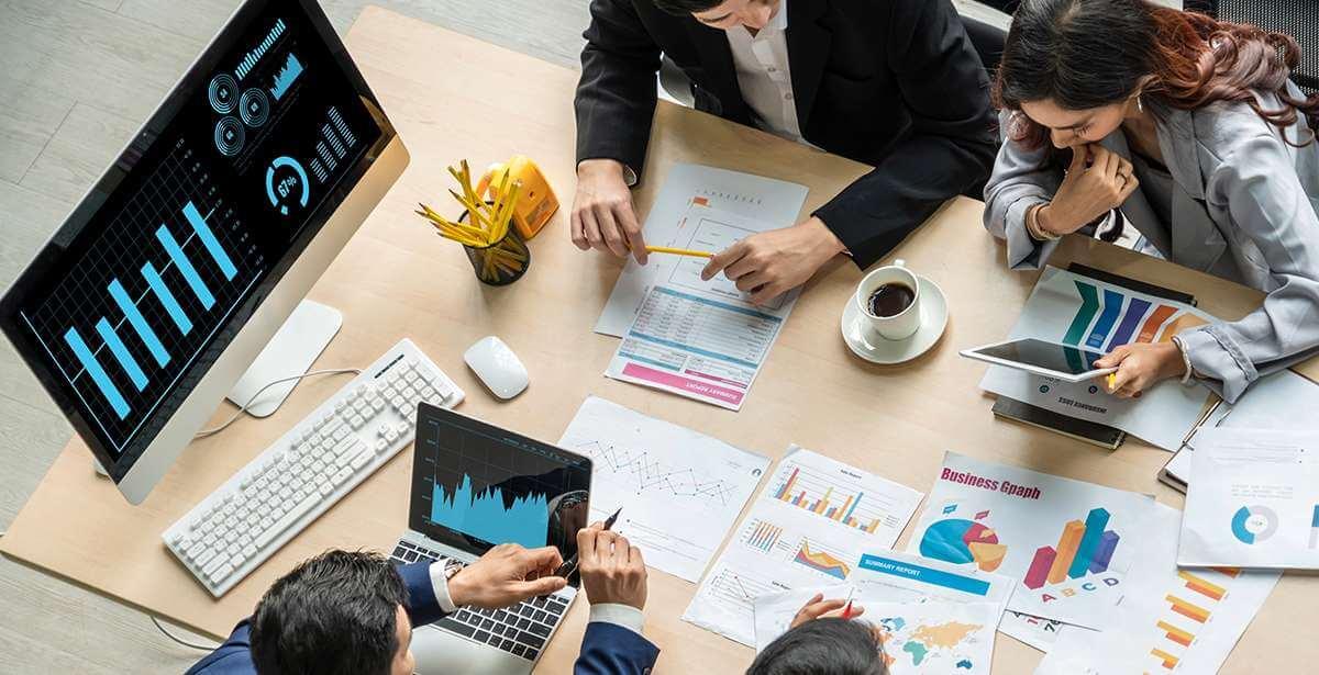 Marketing team reviews data analytics to make revenue growing decisions